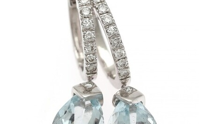 A pair of aquamarine and diamond ear pendants each set with a pear-shaped aquamarine flanked by diamonds, mounted in 18k white gold. (2)