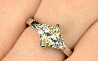 A platinum marquise-shape 'yellow' diamond ring, with brilliant-cut diamond trefoil shoulders, attributed to Hans D. Krieger.