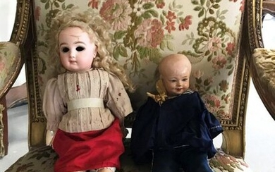 A porcelain twin doll (with a damaged head),...