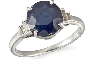 A sapphire single stone ring, the oval sapphire in claw mount to graduated baguette-cut diamond two stone stepped shoulders, ring size J