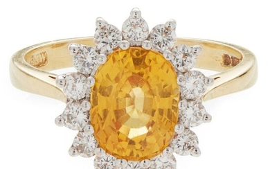 A yellow sapphire and diamond set cluster ring claw set...