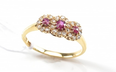 AN ANTIQUE TRIPLE CLUSTER RUBY AND ROSE CUT DIAMOND RING IN 18CT GOLD, RING SIZE L, 2.5GMS