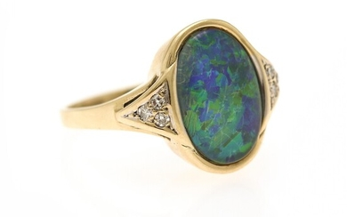 An opal and diamond ring set with a cabochon opal flanked by six single-cut diamonds, mounted in 14k gold. Size app. 53.