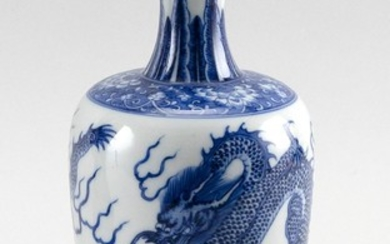 CHINESE BLUE AND WHITE PORCELAIN VASE In rouleau form, with decoration of two five-clawed dragons chasing a fiery pearl. Six-charact...