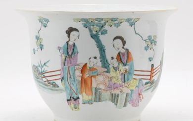 """CHINESE FAMILLE ROSE PORCELAIN JARDINIÈRE With courtyard decoration. Drilled. Height 7.5"""". Diameter 10.5""""."""