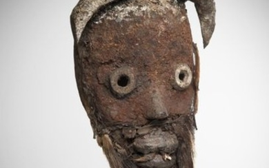 DAN/TOURA, Côte d'Ivoire. Mask with curved frontal horns....