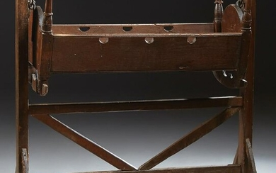 French Provincial Carved Cherry Cradle, 19th c., with