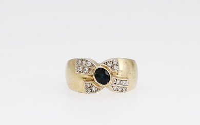 Gold and gemstones ring.