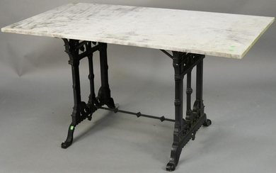 Iron base table with rectangle marble top. ht. 28 in.