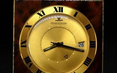 JAEGER LeCOULTRE. PENDULETTE alarm clock in gilded metal enamelled in imitation of the magnifying glass, the dial with date window.