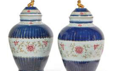 ■ƒ PAIR OF LARGE POTICHES COVERED IN PORCELAIN FROM THE ROSE CHINA FAMILY, QING DYNASTY, 18th-19th CENTURY Resting on a flared base, the body decorated with blue enamelled stylised petals, the central register decorated with flowery scrolls, the lid...