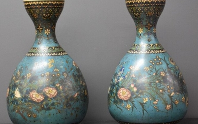 Pair of Japanese porcelain vases imitating the Chinese cloisonne. Ht 36 cm. Cooking crack on the shard.