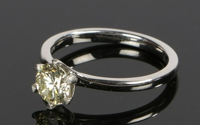 Platinum and diamond set solitaire ring, the round cut