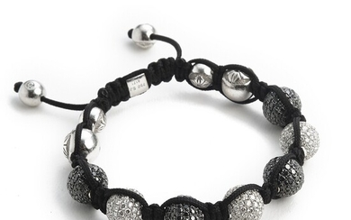 Shamballa: A diamond bracelet set with numerous brilliant-cut black and white diamonds weighing a total of app. 13.00 ct., mounted in 18k white gold.