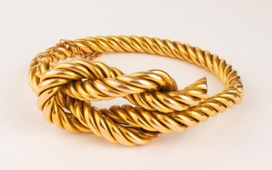 18k (750 thousandths) yellow gold bracelet with a Heracles knot on top. Safety chain. Slight dents and small traces of wear.