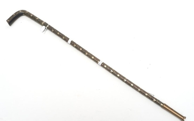 A 19TH CENTURY PROFUSELY INLAY SILVER WALKING STICK, POSSIBLY CHINESE ORIGIN L.77CM
