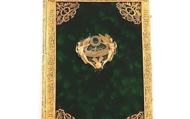 A 19th century French gilt metal mounted aide memoire, rectangular form, the mounts with foliate scroll decoration, green lacquered body mounted ~Souvenir~, with a stylus with a sword hilt handle, length 9.7cm.