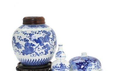 A Chinese blue and white porcelain jar and a vase of gourd-shape; further a low,...