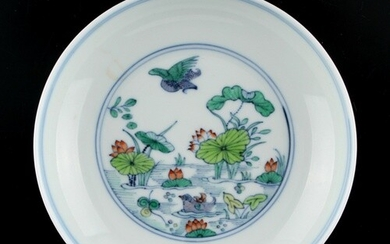 A Chinese doucai saucer dish painted with a pond scene, unde...