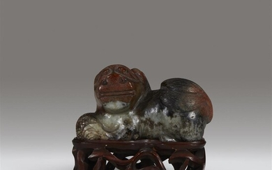 A Chinese grey and russet-brown jade Buddhist lion Ming/early...