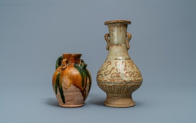 A Chinese sancai ewer and a celadon glazed bottle vase, Tang and Song