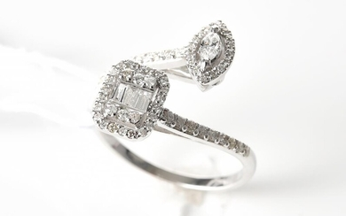 A DIAMOND CROSS OVER DRESS RING IN 18CT WHITE GOLD, COMPRISING MIXED CUT DIAMONDS TOTALLING 0.37CT, SIZE N, 3.5GMS