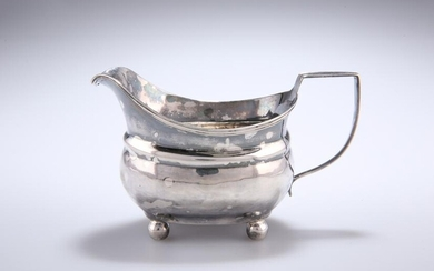 A GEORGE III SILVER CREAM JUG, London 1810, with reeded