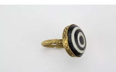 A Gilt Metal mounted Blue & White banded Stone Ring with cir...