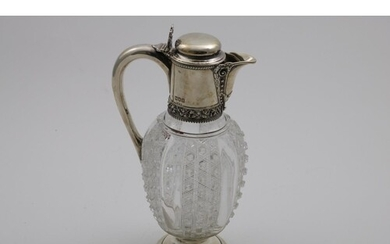 A LATE VICTORIAN MOUNTED CUT-GLASS CLARET JUG with an ovifor...