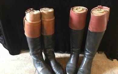 A PAIR OF BLACK AND TAN LEATHER RIDING BOOTS Bearing labels...