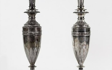A Pair of English Victorian Silver Candlesticks.