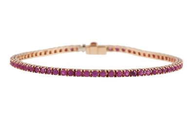 A RUBY SET LINE BRACELET, the rubies set in yellow gold. Est...