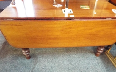 A Victorian mahogany drop leaf table having fluted and turne...
