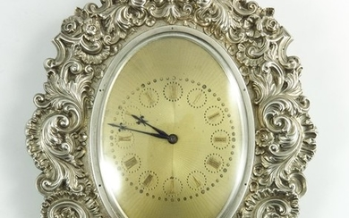 A Victorian silver manual winding clock, the Rococo style fr...