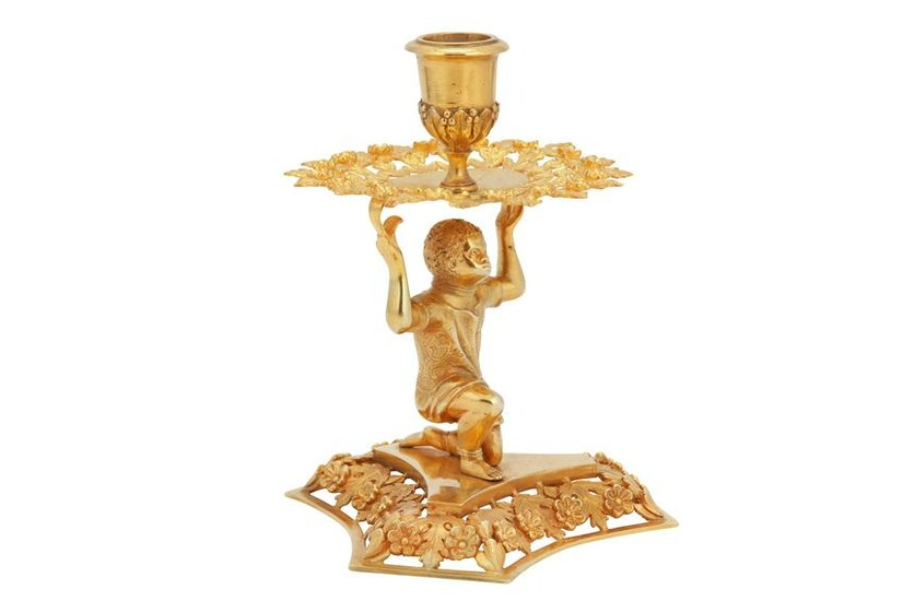 A Victorian sterling silver gilt figural candlestick