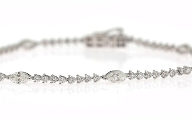 NOT SOLD. A diamond bracelet set with numerous marquise and brilliant-cut diamonds weighing a total...