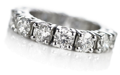 A diamond eternity ring set with numerous brilliant-cut diamonds weighing a total of app. 4.37 ct., mounted in 18k white gold. F-G/SI. App. size 53.