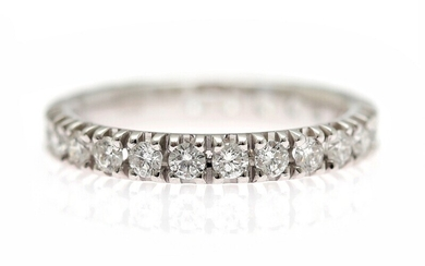 A diamond eternity ring set with numerous diamonds weighing a total of app. 1.07 ct.,...