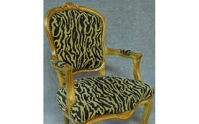 A gilt framed French style fauteuil in leopard print upholst...