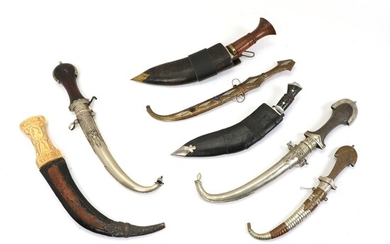 A good Persian 18th cent. Khanjar dagger with a carved grip in walrus and 6 knives of tourist quality.