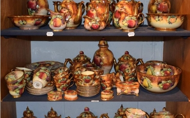 A large collection of Evesham Lime House Studio fruit decorated...