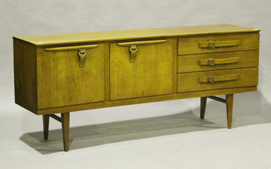 A mid-20th century teak sideboard by Beautility, the inverted front fitted with stylized belt buckle