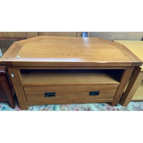 A modern oak TV table with drawer