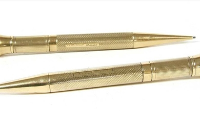 A pair of 9ct gold propelling pencils