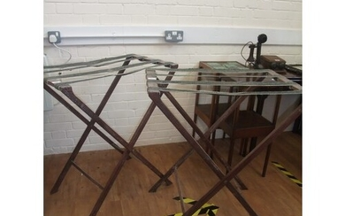A pair of early 20th century mahogany luggage stands, with w...