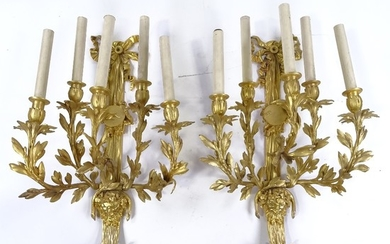A pair of gilt-bronze 5-branch wall light fittings, decorate...