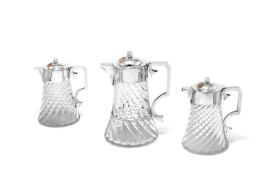 A set of three Victorian silver-mounted cordial jugs