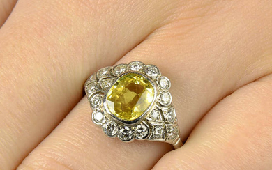 A yellow sapphire and diamond cluster ring.