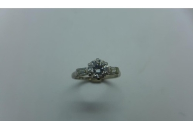 An 18ct white gold and platinum solitaire diamond ring, the ...