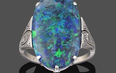 An Art Deco Black Opal and Diamond Ring, the oval...